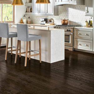 dark solid oak hardwood in kitchen   The Flooring Place