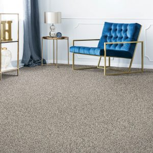 blue accent chair on carpet | The Flooring Place